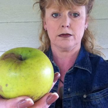 woman holds apple